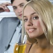 Woman drinking champagne - Stock Photo