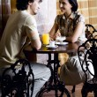 Young smiling couple in old cafe — Stok fotoğraf