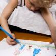 Royalty-Free Stock Photo: Portrait of school boy drawing something with highlighter