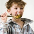 Little boy with a spoon in mouth  — Stock Photo #10713128