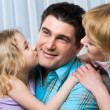 Daughter kissing her happy father — Stock Photo