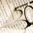 Image of glasses lying on a book - Stock Photo