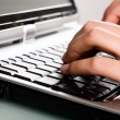 Stock Photo: Close-up of typing hands