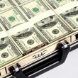 Briefcase full of dollars - Stock Photo