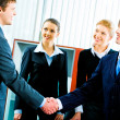 Handshake at meeting — Stock Photo