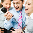 Shouting in telephone receiver - Stock Photo