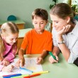 Stock Photo: Teacher with children