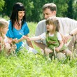 Family in forest — Stock Photo