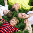 Image of smiling young boys and girls playing on the grass — Stock Photo #10719190