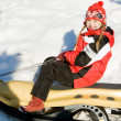 Girl on the sledge - Stock Photo
