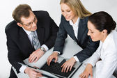 Image of three business working at meeting — Stock Photo