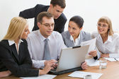 Portrait of business discussing new project at meeting in office — Stock Photo