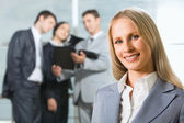 Face of successful business woman looking at camera with smile — Stock Photo