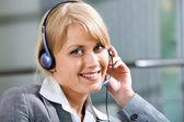 Portrait of friendly customer service representative during work — Stock Photo