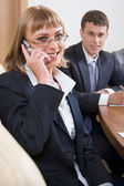 Portrait of beautiful business woman calling on the telephone — Stock Photo