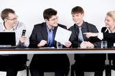 Portrait of smart business sitting at table and interacting — Stock Photo