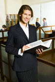 Woman in the library — Stock Photo
