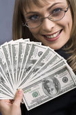 Beautiful businesswoman holding money. — Stock Photo