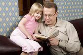 Reading a book — Stock Photo