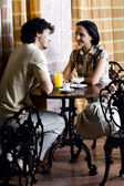 Young smiling couple in old cafe — Stock Photo