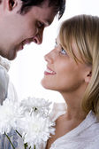 Young loving couple looking to each other — Stock Photo