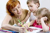 Mother with her children — Stock Photo