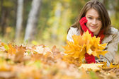 Girl upon leafed ground — Stock Photo