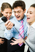 Shouting in telephone receiver — Stock Photo