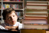 Pupil in library — Stock Photo