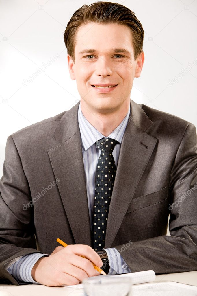 Portrait of confident boss sitting at the table and looking at camera — Stock Photo #10710086