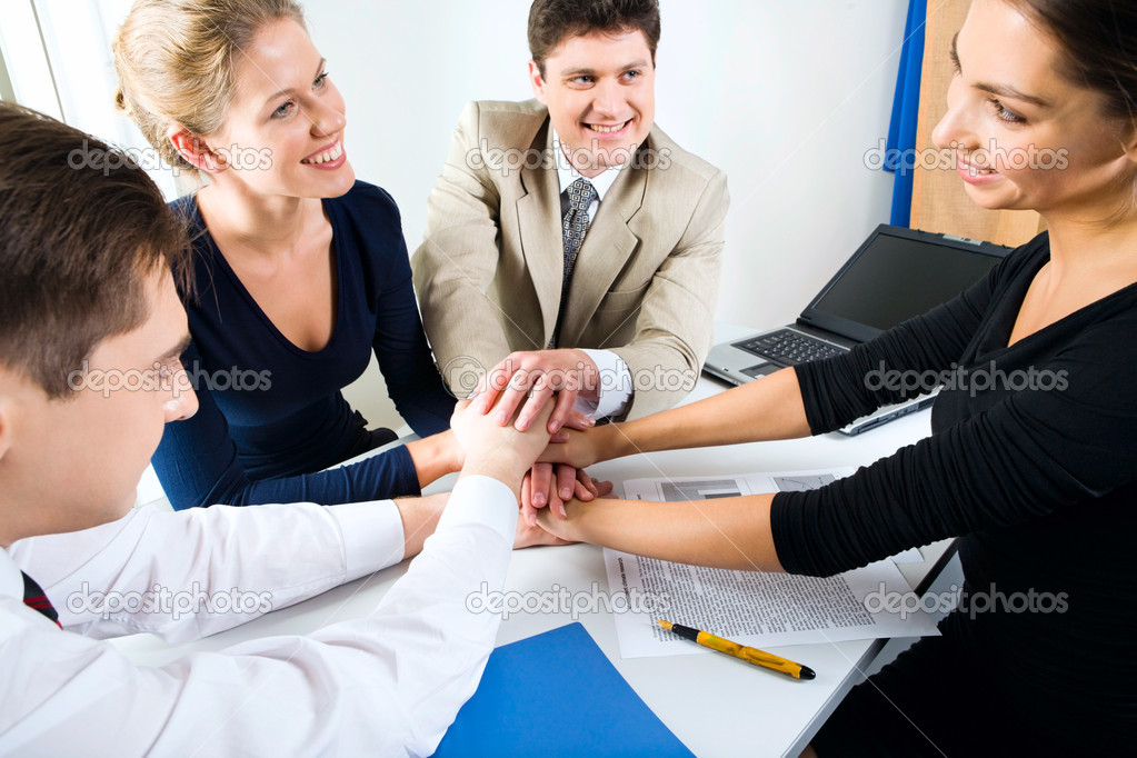 Business team putting their hands on top of each other — Stock Photo #10711089