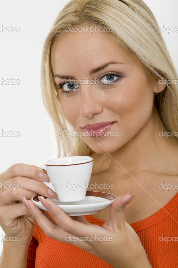 The portrait of young blonde woman with a cup of coffee in her hands  Stock Photo #10712414