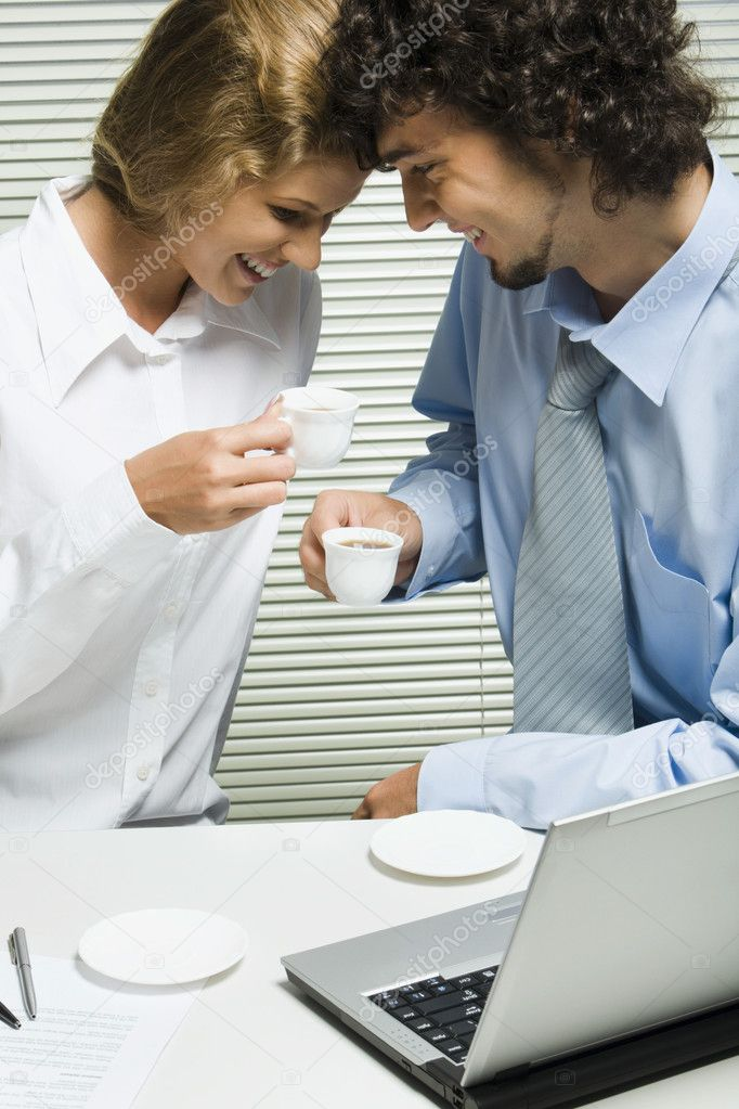 Photo of friendly business partners talking while drinking coffee in office — Stock Photo #10713073