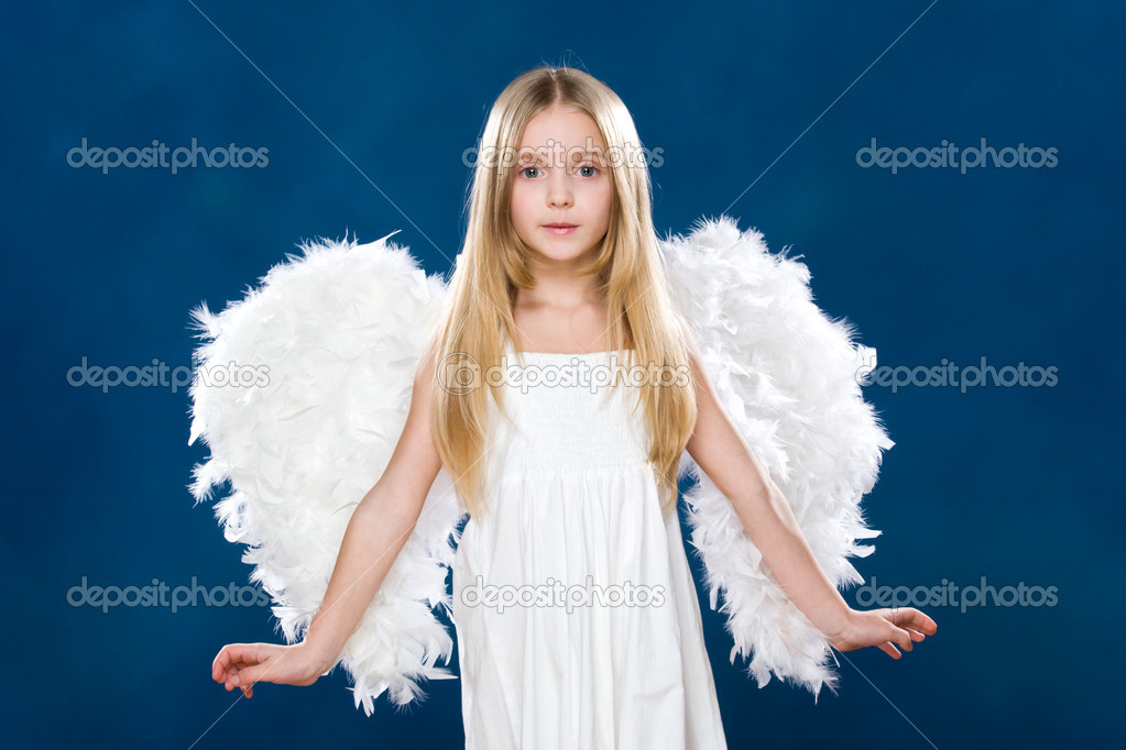 Portrait of happy angel wearing white clothing and wings over blue background — Stock Photo #10713174