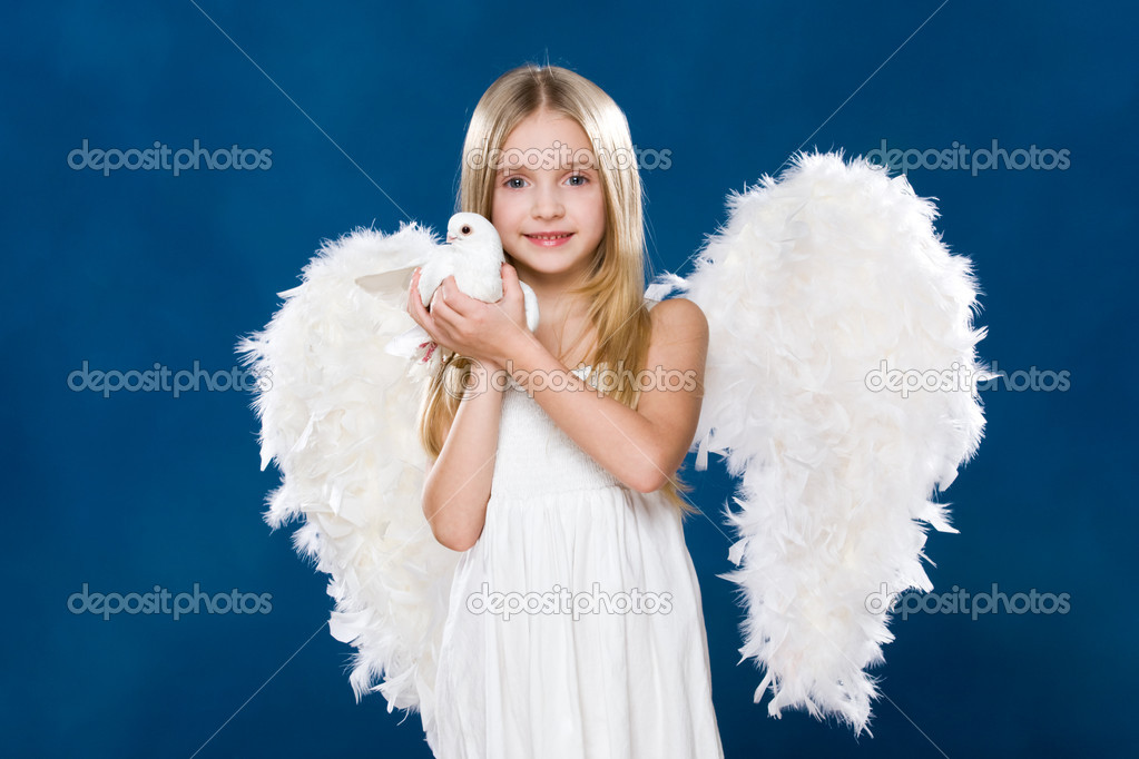 Portrait of glad angel holding white dove in hands and looking at camera — Stock Photo #10713176