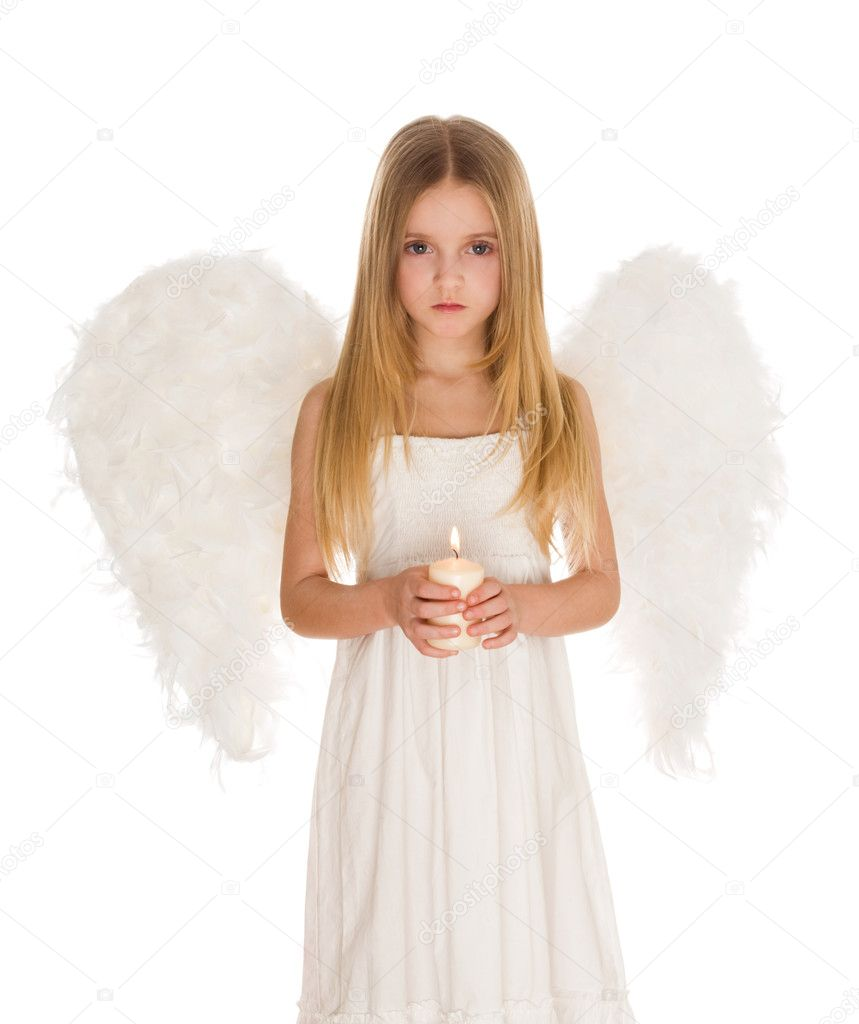 Portrait of girl in angelic costume holding candle — Stock Photo #10713178