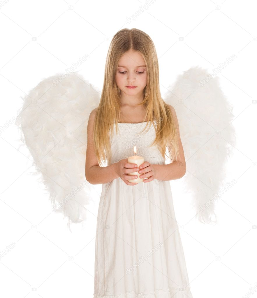 Portrait of white angel holding burning candle and looking at it over light background — Foto Stock #10713180