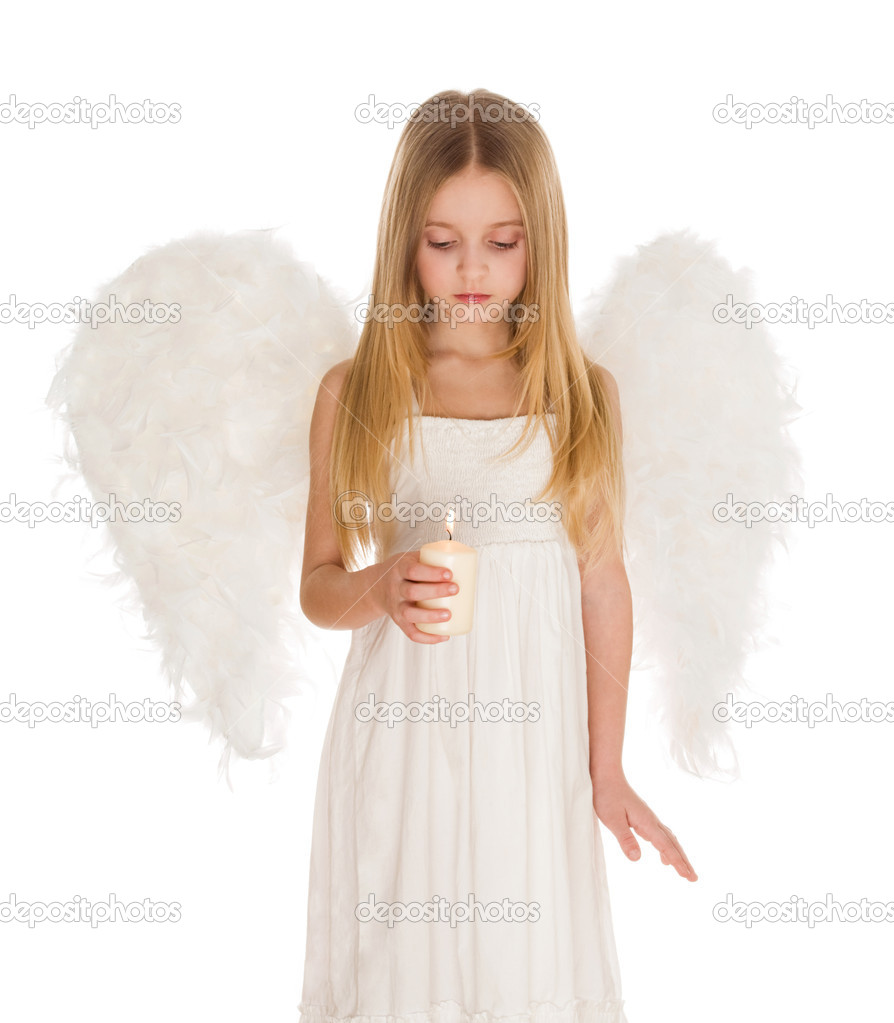 Image of cute girl with white wings behind and lit candle in hands  Stock Photo #10713185