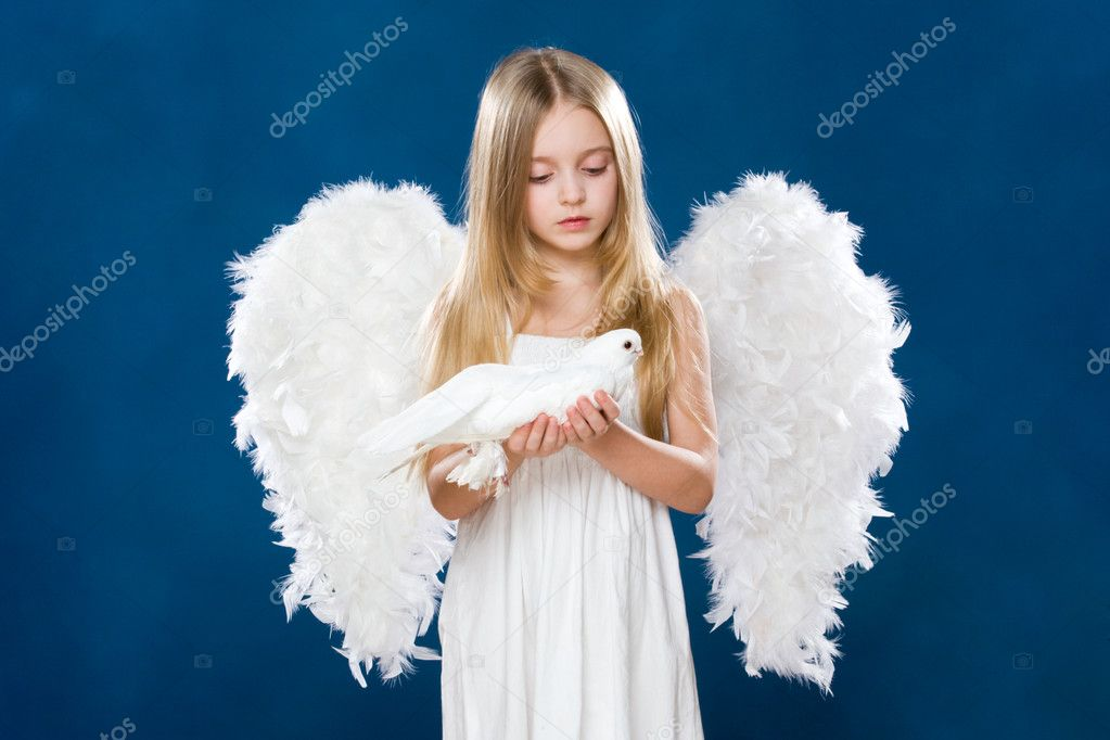 Portrait of innocent angel with nice dove looking at it with love  Stock Photo #10713221