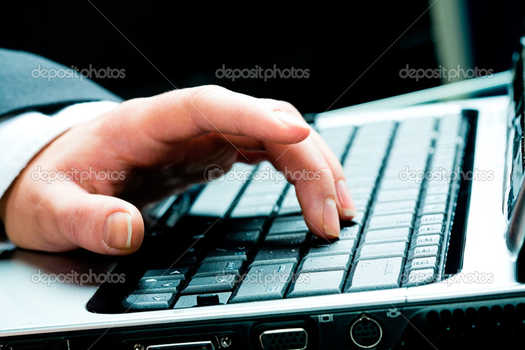 Horizontal image of female hand lying on the keyboard  Stock Photo #10714985