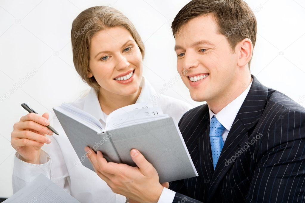 Portrait of attractive secretary and boss discussing schedule of works — Stock Photo #10715248