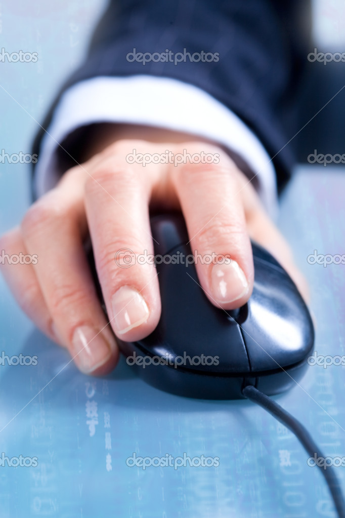 View of businesswoman's hand using a computer mouse doing a project — Stock Photo #10715300