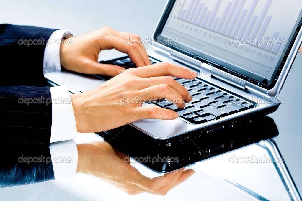 Image of human hand typing a business document on the laptop — Stock Photo #10715304