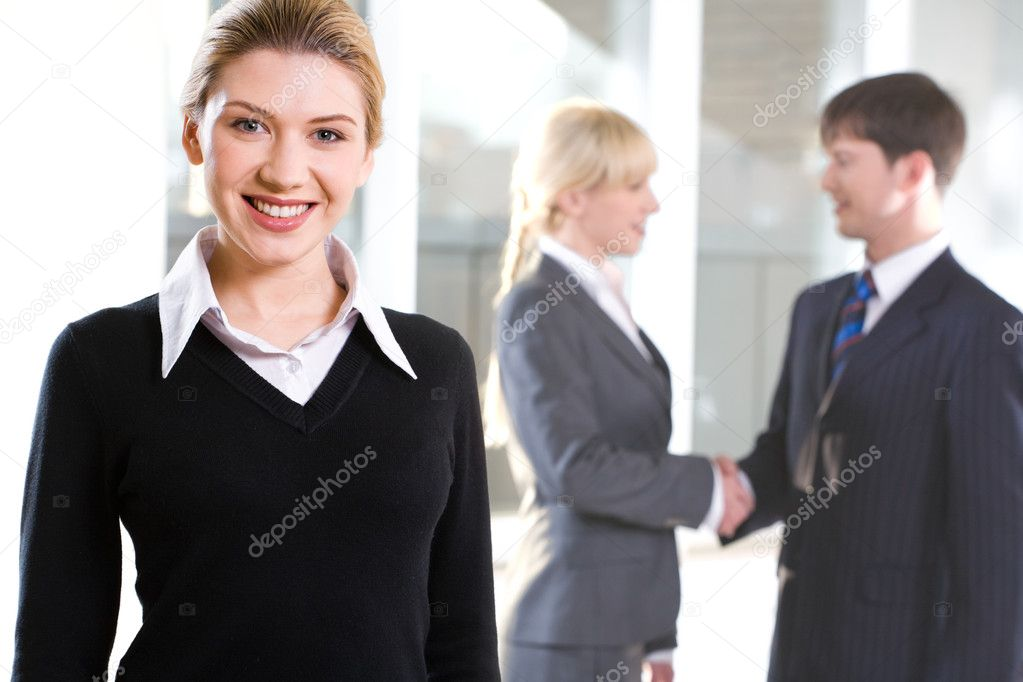 Portrait of beautiful woman on the background of shaking hands — Stock Photo #10715673