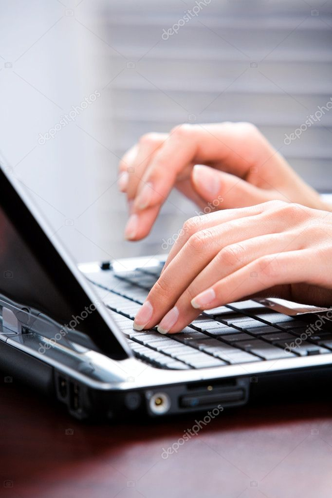 Image of hands typing a letter on the keyboard of laptop — Stock Photo #10715702
