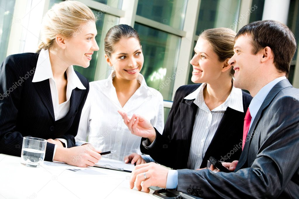 Portrait of four white collar workers discussing a new plan  Stock Photo #10715828