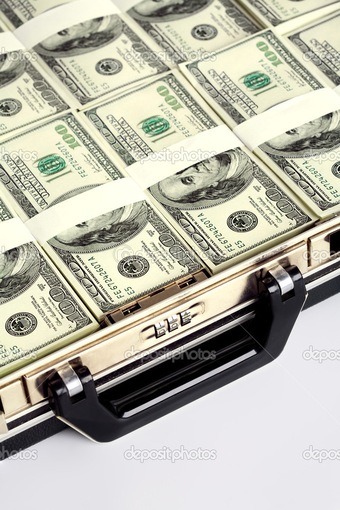 Close-up of briefcase with plenty of US dollars in it — Stock Photo #10715863