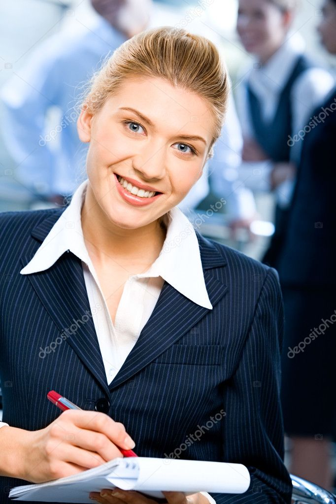 Portrait of strong secretary looking at camera during writing of text — Stock Photo #10715866