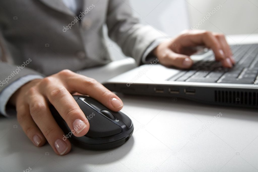 Image of hands pushing keys of a computer mouse and keyboard — Stock Photo #10716040