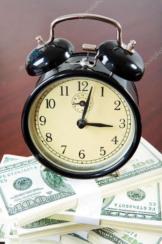 View from above of clock upon heap of dollars on the surface of table — Stock Photo #10716385